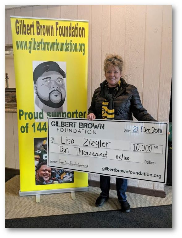 Lisa Zigler holding check